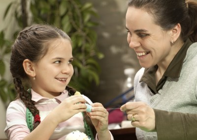 girl and mom sewing, istock photo